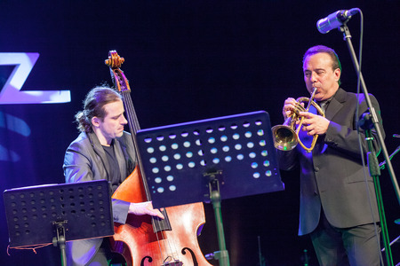 bass player: KAUNAS, LITHUANIA - APRIL 24, 2015: Double bass player Pawel Panta and trumpetist Gary Guthman performs at the stage of \\\\\\\\\\\\\\\Kaunas Jazz\\\\\\\\\\\\\\\ festival as a members of Wlodek Pawlik Project.