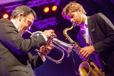 quintet: KAUNAS, LITHUANIA - APRIL 25, 2015:  Till Bronner Quintet performs at the stage of Kaunas Jazz festival.
