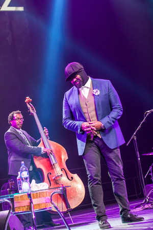 bass player: KAUNAS, LITHUANIA - APRIL 26, 2015: Grammy winner jazz singer Gregory Porter and bass player Aaron James perform at the stage of Kaunas Jazz festival. Editorial