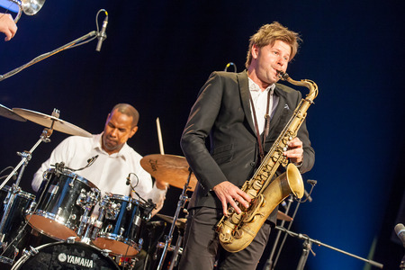 quintet: KAUNAS, LITHUANIA - APRIL 25, 2015: Jazz musician Magnus Lindgren and jazz drummer David Haynes  performs at the stage of Kaunas Jazz festival as a members of  TILL BRONNER QUINTET.
