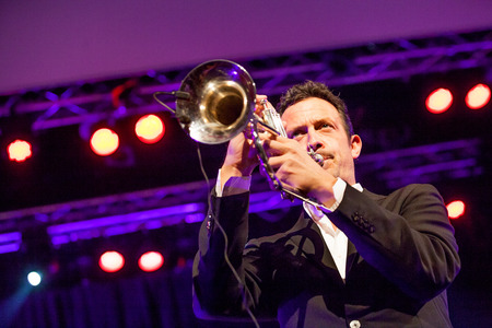 nominated: KAUNAS, LITHUANIA - APRIL 25, 2015: German jazz musician Till Broner nominated for a Grammy Award in 2008 and 2009 performs at the stage of Kaunas Jazz festival.