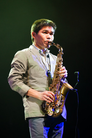 kaunas: KAUNAS, LITHUANIA - APRIL 26, 2015: Jazz musician Yosuke Sato performs at the stage of Kaunas Jazz festival.
