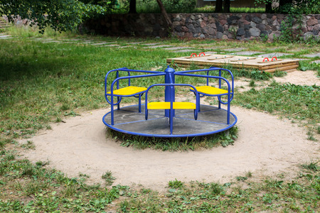 roundabout: Blue roundabout in empty playground