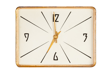 seven o'clock: Vintage rectangle clockface in golden yellow frame showing seven oclock isolated over white background