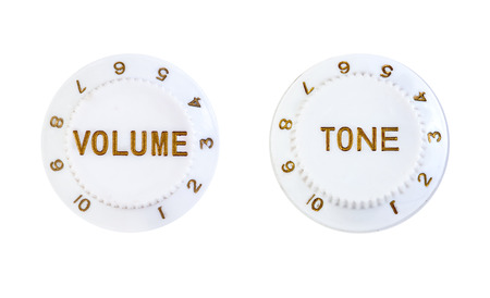 close ups: Close ups of volume and tone control buttons isolated over white background