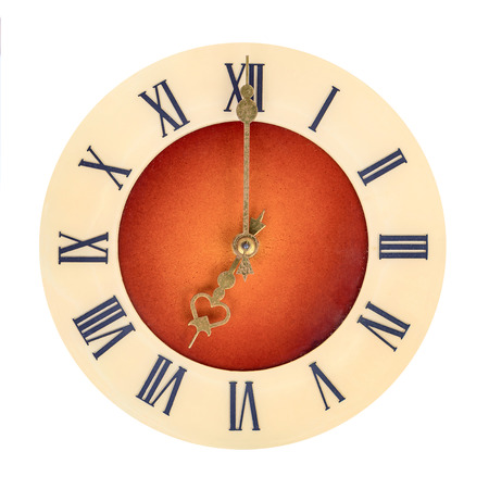 seven o'clock: Clock face with roman numerals showing seven oclock isolated over white background