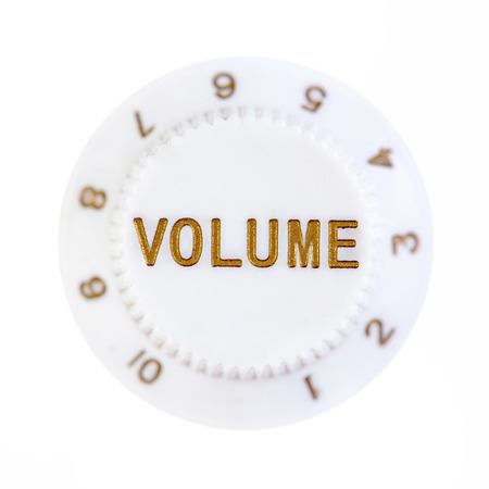 turn dial: Volume control button with blurred number scale isolated over white background Stock Photo