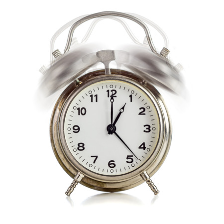 alarming: Alarming old dirty vintage metal clock showing one oclock over white background Stock Photo