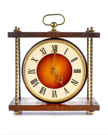 age 5: Old clock with roman numerals showing five oclock over white background Stock Photo