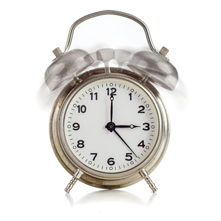 alarming: Alarming old dirty vintage metal clock showing three oclock over white background Stock Photo