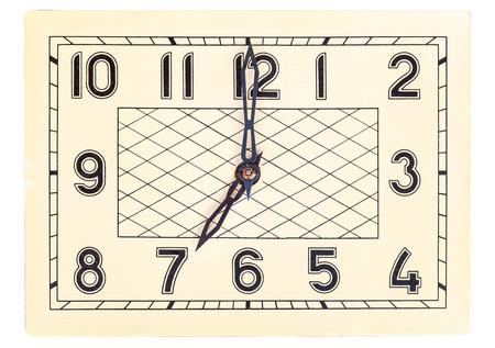 seven o'clock: Rectangular art deco design clock face showing seven oclock isolated over white