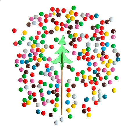 sucker: Candy christmas tree sucker and color sweet buttons drage isolated over white