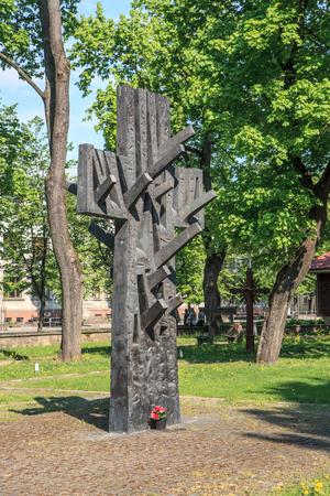 architector: KAUNAS, LITHUANIA - MAY 10, 2016: Cross-tree, the monument in Kaunas Ramybes Park memorating the victims of The June Uprising in 1941. Monument author Robertas Antinis, architector Eugenijus Miliunas.