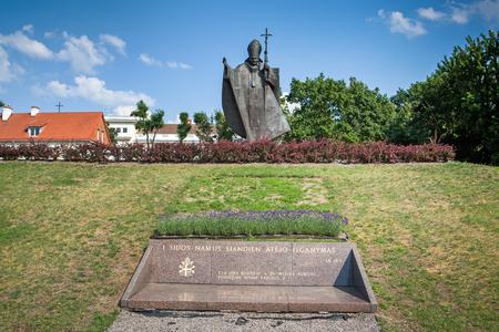 pope: KAUNAS, LITHUANIA - June 25, 2016: Pope John Paul II monument in Kaunas, erected in June 04, 2011 on the hill visited by the Pope in 1993. The author of the monument is Czeslaw Dzwigaj