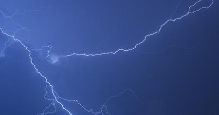 thundershower: Strike of lightning in the night sky Stock Photo