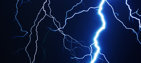 blue waves: Strike of lightning in the night sky Stock Photo