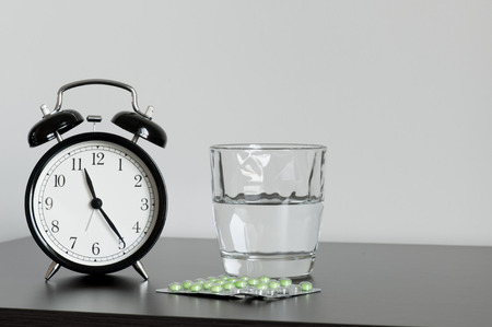 pills in hand: Clock and Pills Stock Photo