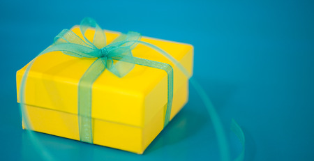 Yellow Gift Box on a Blue