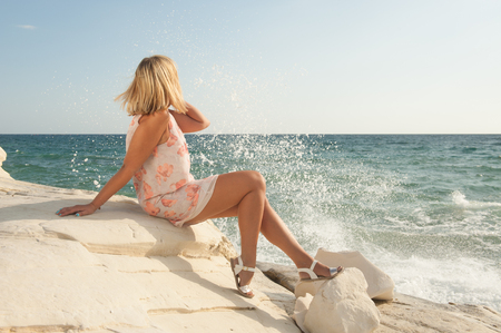 turn away: Blond woman relaxing on the seaside