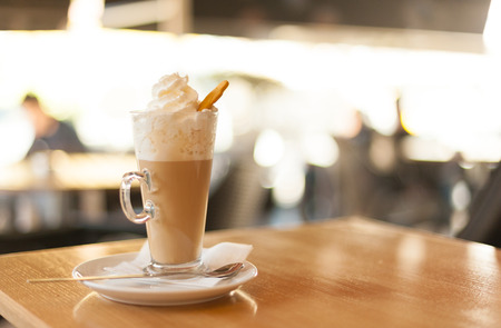 Cup of coffee latte with whipped cream and gingerbread Stock Photo