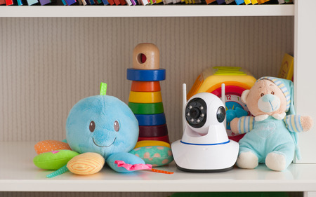 ip cam: IP camera on the shelf with toys, serving as a baby monitor