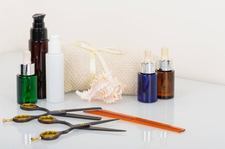 Hair-cutting shears and thinning shears with hair products Stock Photo