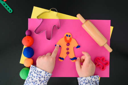 Making the gingerbread man with modelling clay (salt dough) and tools Stock fotó