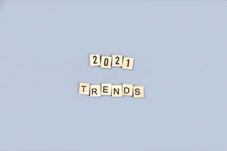 2021 trends made of wooden blocks flat lay on blue background top view. Merry christmas and new year celebration. New popular themes, topics, subjects. Goals and plans. Social media future