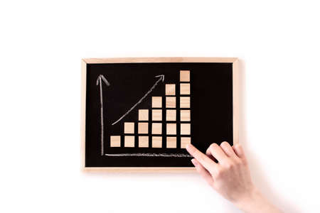 Chalkboard with ladder made of wooden blocks arrows up. Increase, rise, grow up. Business statistic. Career, money, success. Financial progress step by step on stacking blocks. Business flat lay.