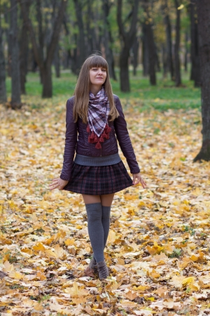 leg warmers: young girl among yellow leaves