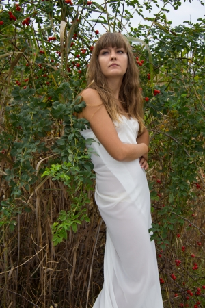 girl in a white dress on the nature photo