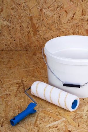 Set for painting bucket of white paint roller photo