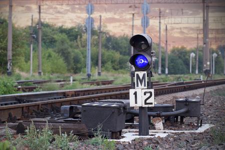 Railway arrow on sunset background photo