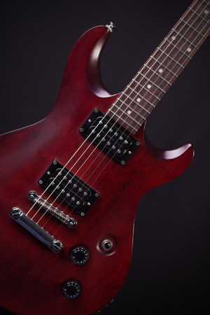 Electric guitar mahogany on a gray background