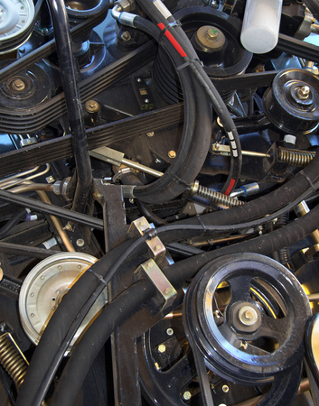 Motor harvester, agricultural motor vehicle parts, part of the diesel engine, the engine of the harvester close-up, the engine of the vehicle.