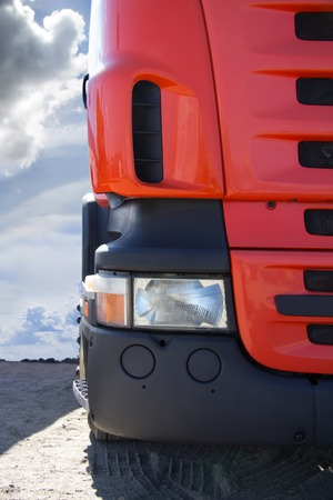 commercial tree service: Yellow truck on the road, transport of heavy loads, the modern freight, cabin powerful truck, a truck transporting goods, delivery of goods, the car against the sky