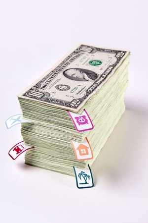 accumulating: Saving money, financial planning, a dream come true, planning costs, packs of dollars, money stacked in bundles, family economics, photography dollars, accumulating money. Stock Photo