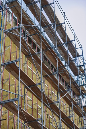 building material: Wall insulation, mineral wool, composite panels cladding of buildings, resource conservation, scaffolding, carrying out aerial work, insulation of facades, building material, building facing work.