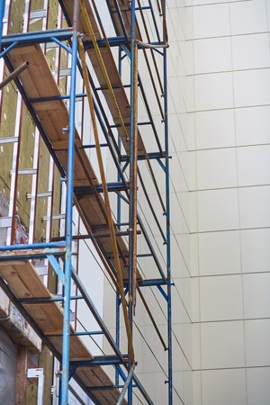 resource conservation: Wall insulation, mineral wool, composite panels cladding of buildings, resource conservation, scaffolding, carrying out aerial work, insulation of facades, building material, building facing work.