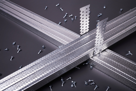 mounting holes: Profile for plasterboard, plasterboard fastening, set of building profiles, building materials, steel profiles for repair, construction works, modern building materials, screws for construction Stock Photo