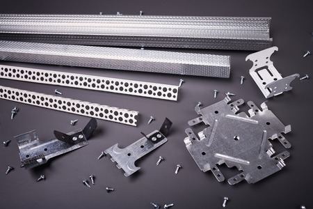 Profile for plasterboard, plasterboard fastening, set of building profiles, building materials, steel profiles for repair, construction works, modern building materials, screws for construction Stock Photo
