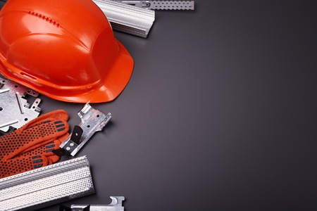 personal protective equipment: Construction helmet, profile for plasterboard, fixing plasterboard, set of building profiles, building materials, steel profiles for repair, construction works, personal protective equipment
