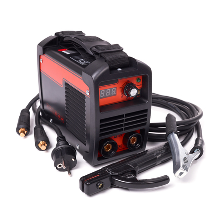 Inverter welding machine, welding equipment isolated on white background, high-voltage wires with clips, set of accessories for arc welding.