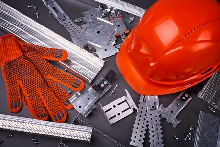 plasterboard: Construction helmet, profile for plasterboard, fixing plasterboard, set of building profiles, building materials, steel profiles for repair, construction works, screws for construction