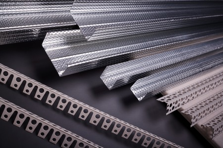 construction materials: Profile for plasterboard, plasterboard fastening, set of building profiles, building materials, steel profiles for repair, construction works, modern building materials, plastic profile