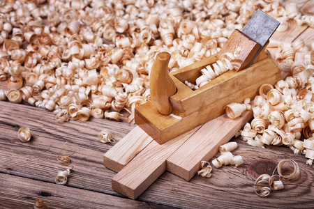 wood planer: Wooden planer, table from old wood, a natural building material, handcrafted wood, ancient hand tools, carrying out carpentry, joinery tools, wood sawdust, old wood texture