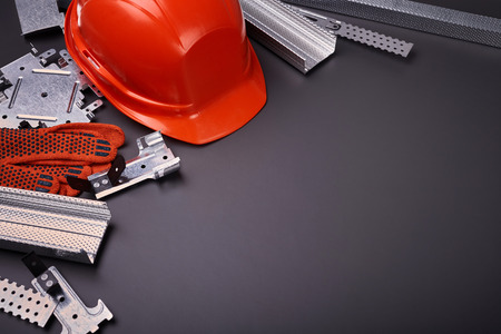 Construction helmet, profile for plasterboard, fixing plasterboard, set of building profiles, building materials, steel profiles for repair, construction works, personal protective equipment