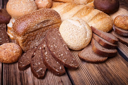 Fresh bread, sweet pastries, baked goods, harvest on the farm, great food, lots of baked goods, healthy food, a table of old wood, close-up bread, wood grain Stock Photo