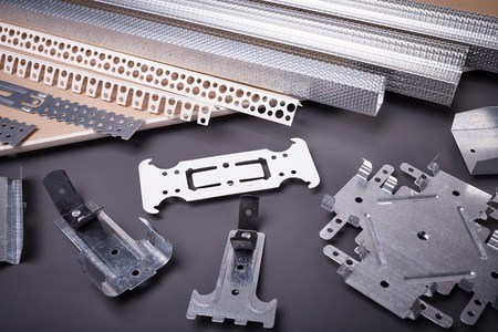 mounting holes: Profile for plasterboard, gypsum board, plasterboard fastening, set of building profiles, building materials, steel profiles for repair, construction works, modern building materials, plastic profile Stock Photo