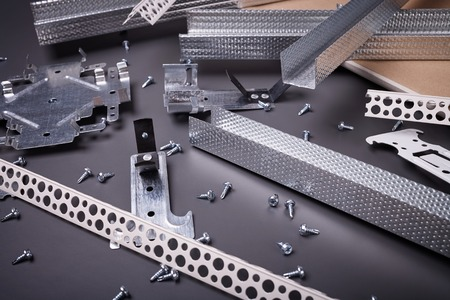 mounting holes: Profile for plasterboard, gypsum board, plasterboard fastening, set of building profiles, building materials, steel profiles for repair, construction works, screws for construction, plastic profile Stock Photo